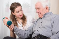 Elder man's home therapy - stock photo