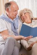 Reading book together - stock photo