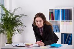 Young woman working in agency - stock photo
