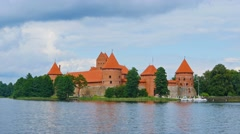 Lithuania, landscape with Trakai castle on the lake shore. Stock Footage