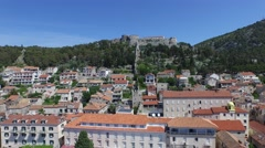 Aerial scene of european town with a castle, fort at the top of a mountain. Stock Footage