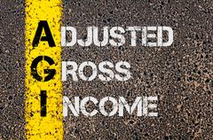Business Acronym AGI as Adjusted Gross Income - stock photo