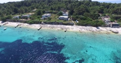 Aerial drone scene of turquoise coast with suburban houses over the coast. Stock Footage
