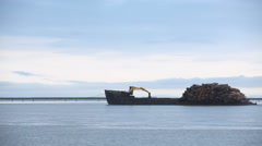 Stock Video Footage of Large Barge Carrying Shipment of Lumber Logs in British Columbia