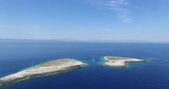 Aerial drone scene of two isolated islands on the dalmatian coast catamaran Stock Footage
