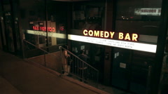 Couple check out show at Comedy Bar Exterior Stock Footage