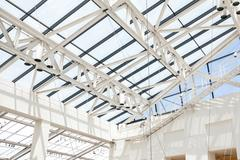 Fragment of roof from glass and a white steel in style hi-tech - stock photo