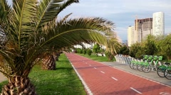 Cycling on bicycle lane. Seaside promenade in Batumi, Georgia Stock Footage