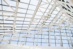 Fragment of roof from glass windows and a steel in style hi-tech - stock photo