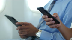 Hand held electronic devices on plane close up Stock Footage