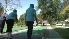 Active Seniors Playing Shuffleboard Outdoors Recreation Retirement Community Stock Footage