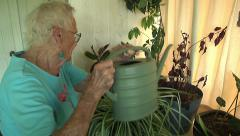 Active Senior Watering Indoor Plants Retirement Community Daily Life Stock Footage