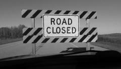 Driving up to ROAD CLOSED sign. Black and white. Stock Footage