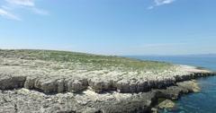 Aerial scene with drone of rocky island, dalmatian coast. Stock Footage