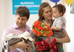 Family in the maternity hospital with newborn - stock photo