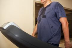 Intensive workout on treadmill, cardio training Stock Photos
