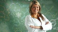 Stock Video Footage of Portrait of a proud teacher in front of a chalkboard