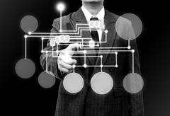 businessman holding a touch screen interface - stock illustration