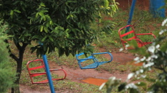 Empty Swingset. Recreation, park, playground. Rainy day. Stock Footage