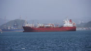Stock Video Footage of SMALL RED FUEL PETROLEUM CARGO SHIP in San Juan Harbor