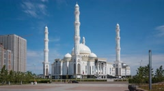 Hazret Sultan Mosque in Astana with the blue sky on the baskground Stock Footage