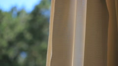 Window curtain on the wind. Curtains floating in the summer breeze Stock Footage