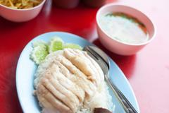 Chicken and rice thai food in soft light - stock photo