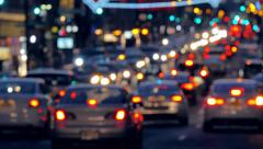 Night shot of busy street traffic during rush hour in New York City Stock Footage