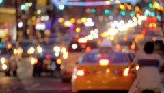 Defocused busy street traffic in New York City at night Stock Footage