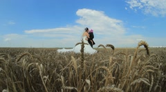 Beautiful Groom and Bride Hugging And Kissing Each Other In the Wheatfield - stock footage