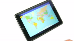 The hand (finger) work with world map on the touchscreen by white background Stock Footage