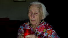 Very Old Woman Blowing In A Candle Lit For The Dear Departed Ones, Loneliness Stock Footage