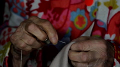 A Very Old Woman Trying to Saw A Hem For Her Blouse, Hands Detail, Still  Stock Footage