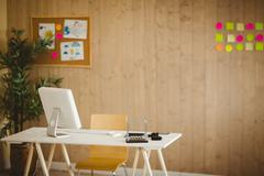 Stock Photo of Creative office with cool wooden paneling