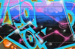 Colorful creative graffiti on wall Stock Photos