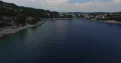 Aerial drone scene of bay with anchored catamaran in dalmatian coast, Croatia. Stock Footage