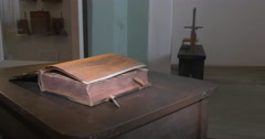 Old Book on The Table Closeup, From the Right Side, Man's Hand is Leafing Stock Footage