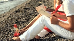 Young Couple Writing Romantic Letters on the Beach Stock Footage