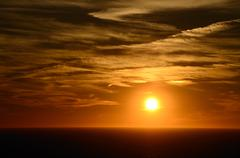 beautiful warm orange sunset at sea with horizon - stock photo