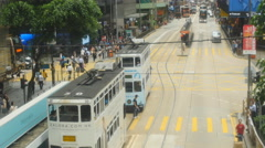 Commutors cross tram track in Hong Kong 4K Stock Footage