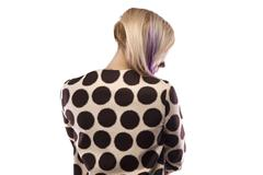 Portrait of woman in spotted coat from back Stock Photos