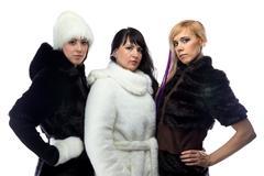 Photo of three women in fur coats Stock Photos