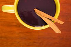 Traditional Ecuatorian dish, colada morada on wood background - stock photo