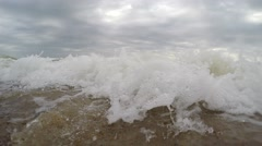 Waves on sandy beach. The beach on the shores of sea. Waves wash chamber Stock Footage