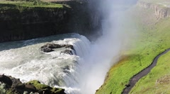 Hvatn River plunging over Gullfoss waterfall in Iceland on a sunny morning Stock Footage