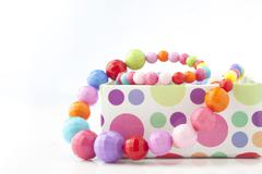 Colorful necklace close up in box on white background Stock Photos