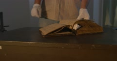 Man in Gloves is Leafing Through The Nestor The Old Book, Chronicler's Book Stock Footage
