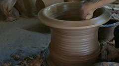 Raising jar on pottery wheel - stock footage