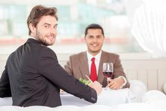 Stock Photo of Attractive young businessmen have an appointment in restaurant