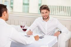 Handsome young businessmen have an appointment in restaurant Stock Photos